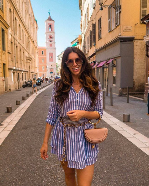 Fashion influencer Nathalie Van den Berg looking great in a blue-white striped Rails dress