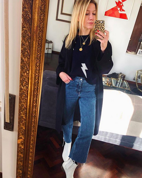 Fashion influencer Florence Ackermans wearing a Rails sweater