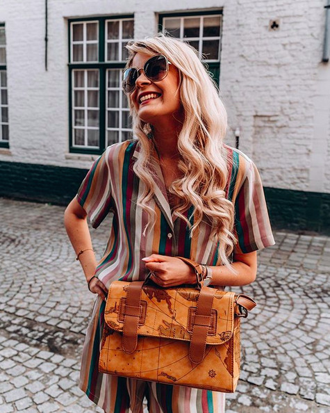 Influencer Yentl Keuppens wearing a colourful Rails ensemble